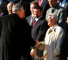 President Bush shakes hands with Pesky in a ceremony at the White House March 2, 2005 in Washington. Boston won the 2004 World Series defeating the St. Louis Cardinals.