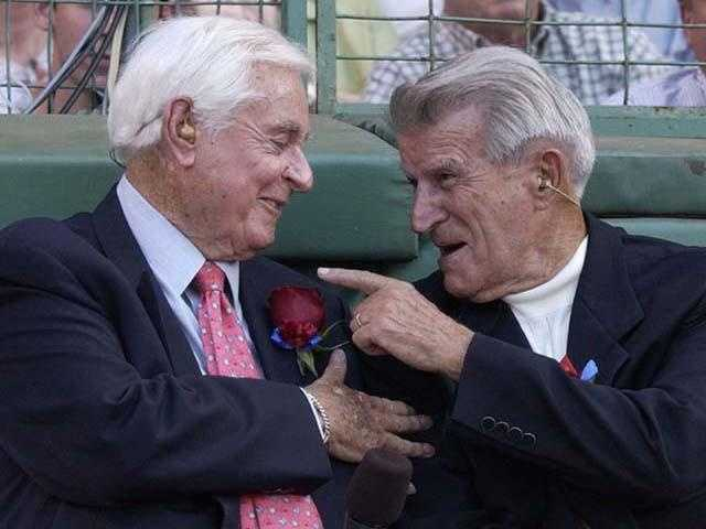 Sportscaster Curt Gowdy jokes with Pesky July 22, 2002 at Boston's Fenway Park during a memorial tribute to Boston Red Sox slugger Ted Williams.