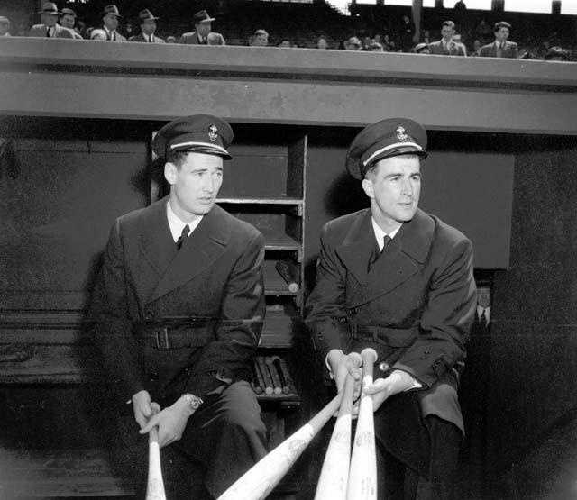 Navy aviation cadets outfielder Ted Williams, left, and shortstop Johnny Pesky watch the action at Fenway Park on April 27, 1943.