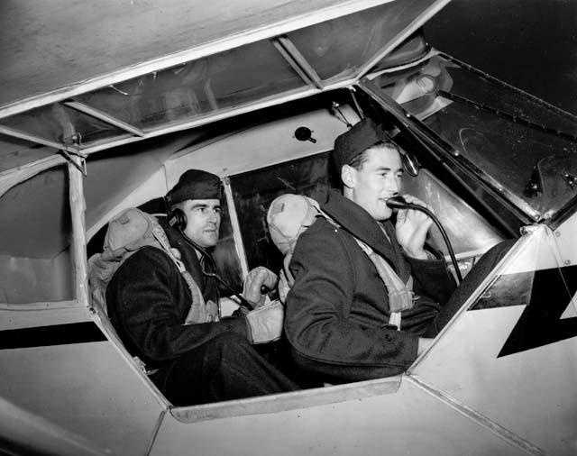 Ted Williams, right, communicates with Johnny Pesky during Naval aviation commissions training, at Amherst College, Dec. 1, 1942