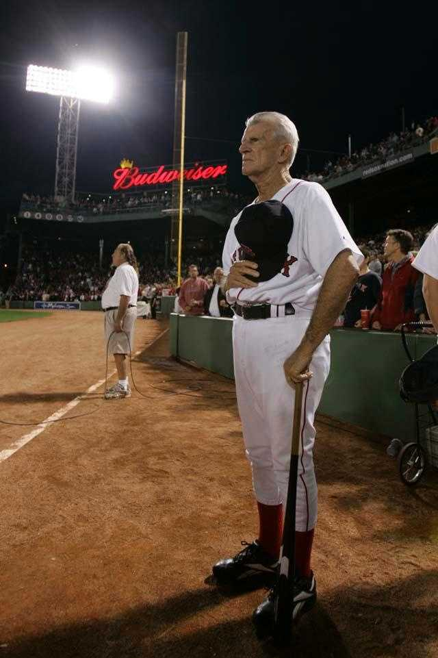 Boston Red Sox great Johnny Pesky stands near the Pesky Pole along the right field line during the National Anthem at Fenway Park Wednesday, Sept. 27, 2006.