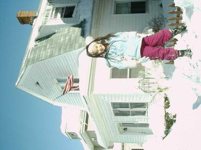 Child on Snow Pile Blizzard
