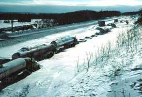 Cars and trucks were trapped in drifts as high as 15 feet.