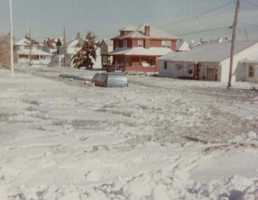 Cars on roads in coastal communities were victims of the flooding.