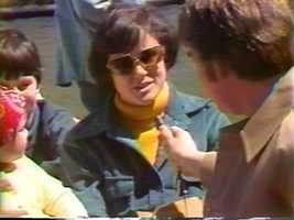 Reporter Paul Steinle talks to riders of Boston's Swan Boats in 1977