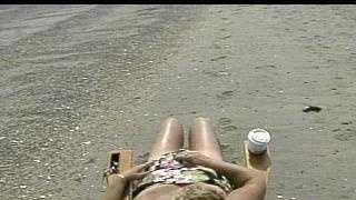 Woman Sun Tanning On Beach - 9391636