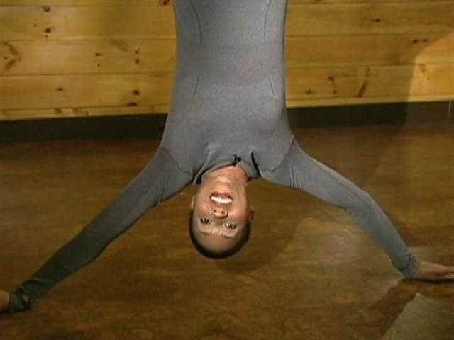 Shayna learned, Anti-Gravity Yoga can put you in unusual positions.