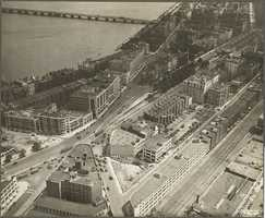 This is a 1929 aerial view of Kenmore Square. The rows of commercial and residential buildings that were torn down to make room for the Mass Pike are visible.