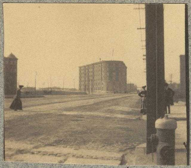In 1880, Kenmore Square was only sparsely developed. In 1890, the Back Bay landfill project reached Kenmore Square connecting it with parts of the city to the east. This is a view in 1900.