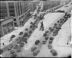 A 1927 picture of Kenmore shows the square covered in snow. The Commonwealth Avenue Mall can be seen at the top right of the picture.