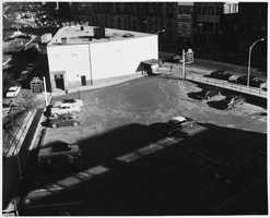 The rear parking lot of the First National Bank in 1950s. A residential building now stands in the lot.