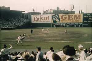 After the 1934 fire, the new wall, minus the Duffy's Cliff seating, was erected in center field. This picture shows the wall in 1950.