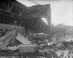 The power of the wave twisted the girders of the Boston Elevated Railway's Atlantic Avenue structure on Commercial Street.