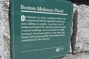 A plaque marking the disaster is located at the entrance to Langone Park on Commercial Street.