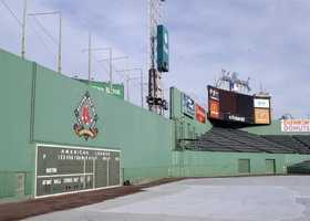 The wall is 37 feet 2 inches tall. It went up with the park in 1912.