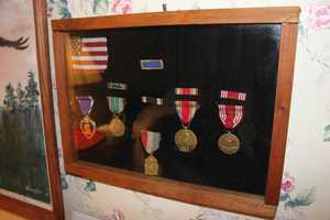 Disario is a decorated WW II hero. Some of his medals here, including his Purple Heart.