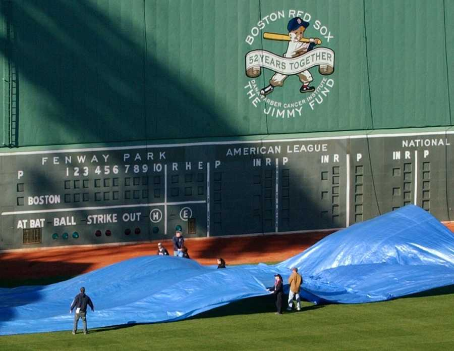 Ground crews make preparations below the Green Monster in 2005. Disario said he hasn't been to a game in years because tickets are too expensive.