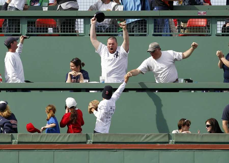 And a new generation of fans is enjoying the Green Monster. Here they react in game against the Yankees in 2011.