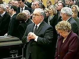 Menino prays at the funeral for former Boston Mayor Kevin White in 2012
