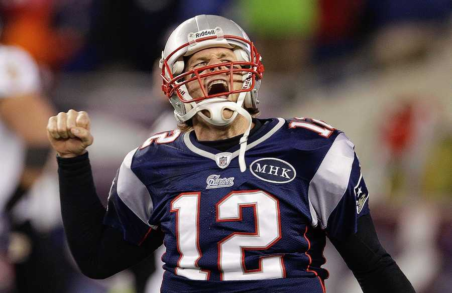 Tom Brady celebrates after scoring a one yard touchdown during the second halfduring the 2012 game.