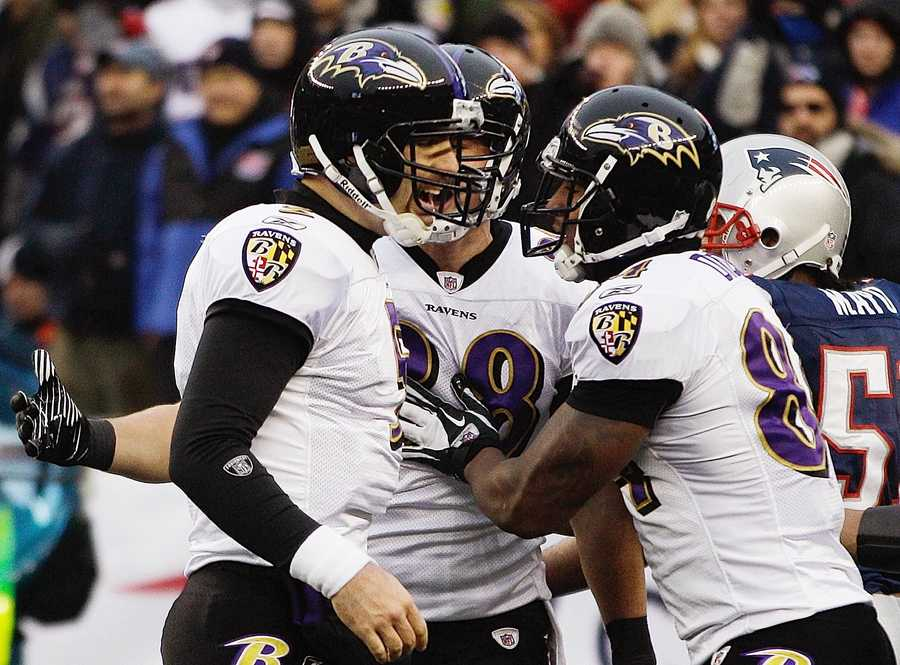 Joe Flacco celebrates with Baltimore Ravens tight end Dennis Pitta and Ed Dickson, right, after his seven yard pass to Pittaduring the 2012 game