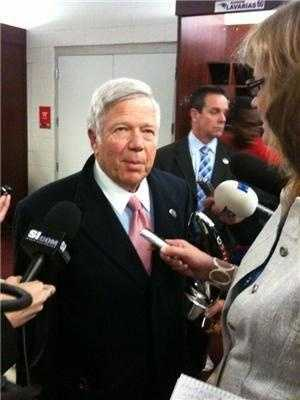 Bob Kraft holds the Lamar Hunt trophy after the game in the locker roomin 2012.