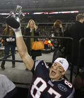 Rob Gronkowski celebrates with the AFC Championship trophy in 2012.