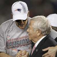 New England Patriots quarterback Tom Brady, left, shakes hands with New England Patriots owner Robert Kraftin 2012.