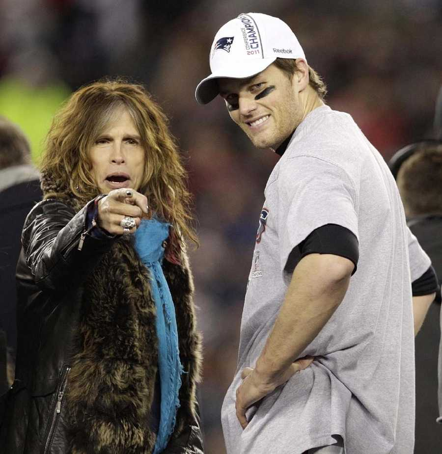 Aerosmith singer Steven Tyler, left, chats with New England Patriots quarterback Tom Brady following the AFC Championshipin 2012.