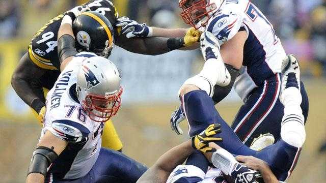 Pittsburgh Steelers outside linebacker LaMarr Woodley (56) sacks New England Patriots quarterback Tom Brady (12) in the second quarter of the NFL football game on Sunday, Oct. 30, 2011, in Pittsburgh. Patriots offensive tackles Sebastian Vollmer (76) and Matt Light (72) keep Steelers inside linebacker Lawrence Timmons (94) away.