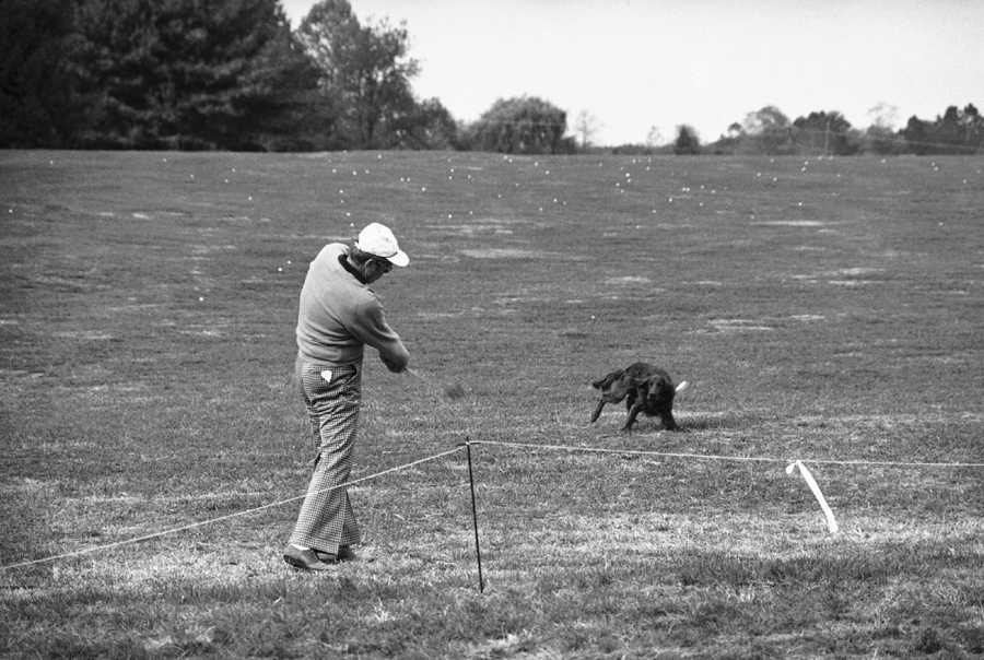 President Carter gets some tips on his golf swing from Jake.