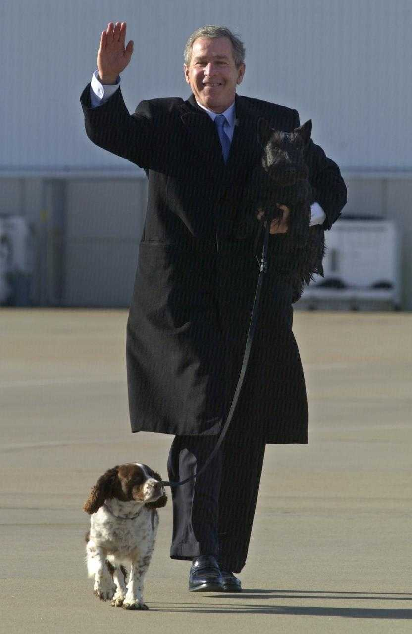 Spot the dog with President George W. Bush and Barney.