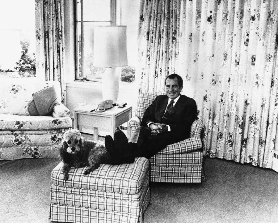 President Nixon with Vicky the poodle in 1974.
