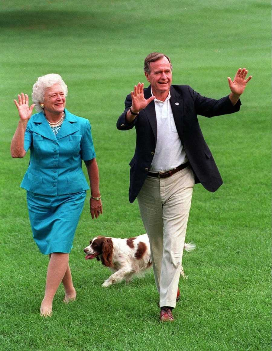 George and Barbara Bush with Millie.