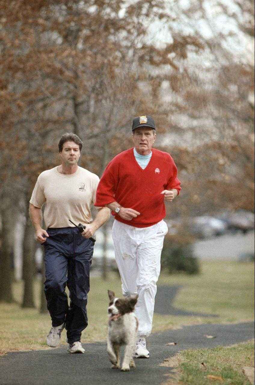 George H. W. Bush and a Secret Service agent are lead on a jog by Ranger in 1991.