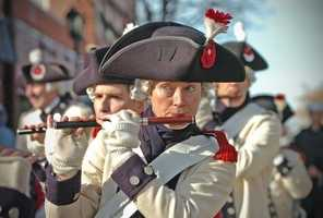 Members of the Middlesex County Volunteer Fifes and Drums march in the parade.