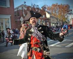 Pirates with the Free Men of the Sea historical interpreters group address the crowd as they march along Court Street.