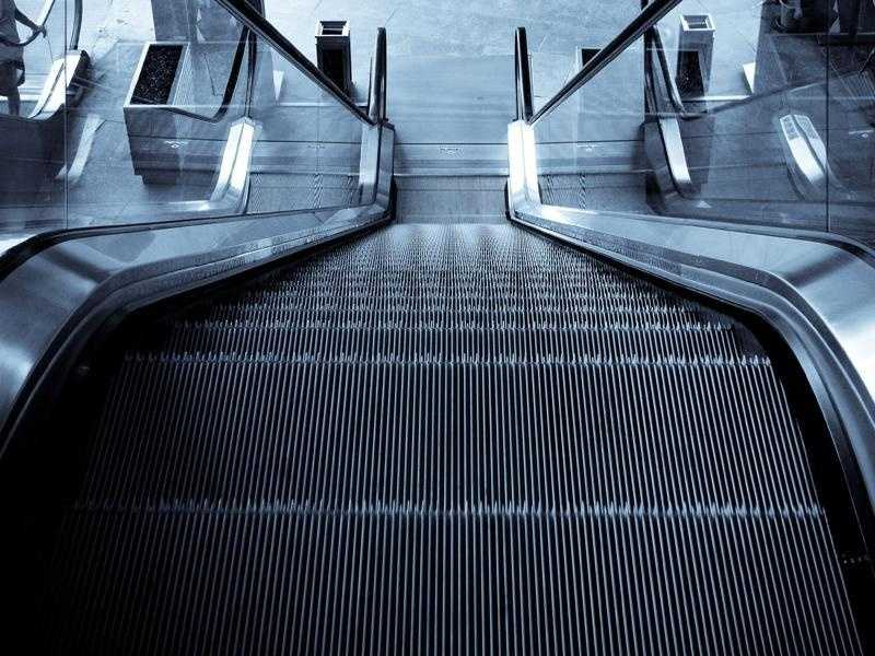 Be wary of what you touch when riding an escalator.
