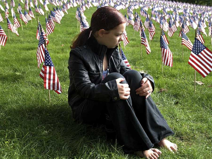 Samantha Morin, who lost her aunt, Theresa Barnes, in the North Tower of the World Trade Center, attached a note to one of 3,000 flags in Marlborough