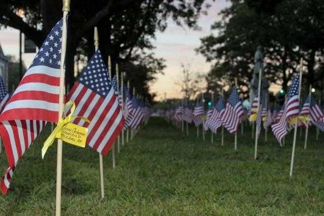 The name of Lynn Catherine Goodchild from Attleboro is displayed on 1 of 92 flags bearing the names of Massachusetts residents killed on Sept 11.