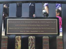 Plaque on a bench in Brookline dedicated to Lt. Manuel DelValle Jr. FDNY Engine Co. #5. He was a graduate of Brookline High School class of 1988. He was one of 343 firefighters killed in the World Trade Center.