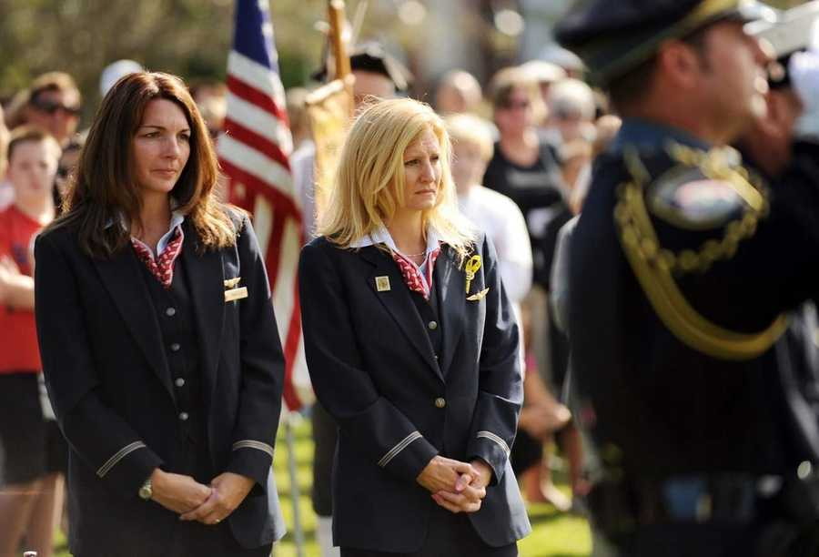 American Airlines flight attendants, Mariellen Martin, left, and Diane Pellegrino attend the 10th anniversary 9/11 observance on the Burlington Town Common. Martin flew with Pilot Thomas F. McGuinness, Jr. who was killed in the 9/11 attacks.
