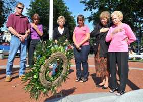 Walatham resident John J. Wenckus was lost on September 11, 2001 in the World Trade Center attacks. Family members joined with Waltham Mayor Jeannette McCarthy (2nd from right) in placing a wreath in memory of all the victims of the 9/11 attacks.