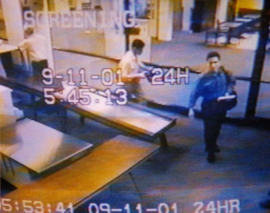 Hijackers Mohamed Atta, right, and Abdulaziz Alomari, center, pass through airport security, at Portland International Jetport in this photo from the airport surveillance tape.