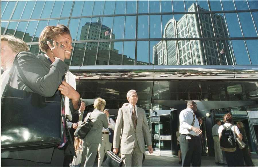 An unidentified woman makes a call on Sept. 11, 2001 in Boston, after she evacuated her office in the John Hancock building.