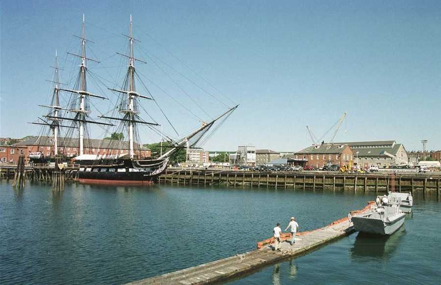 Workers set up a barricade around the U.S.S. Constitution at the Charlestown Navy Yard on Sept. 11, 2001.