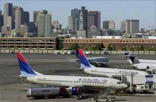 Planes sit idle at gates at Logan International Airport in Boston,Sept. 11, 2001, as airports across the United States are shut down.