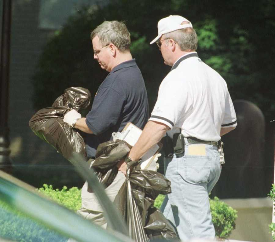 FBI agents carry bags of materials taken from a Newton hotel room, at the Park Inn, where authorities said hijackers stayed.