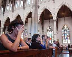 Pattie Kloehn is shown during a memorial service at the Cathedral of the Holy Cross, Sept. 12, 2001, in Boston.