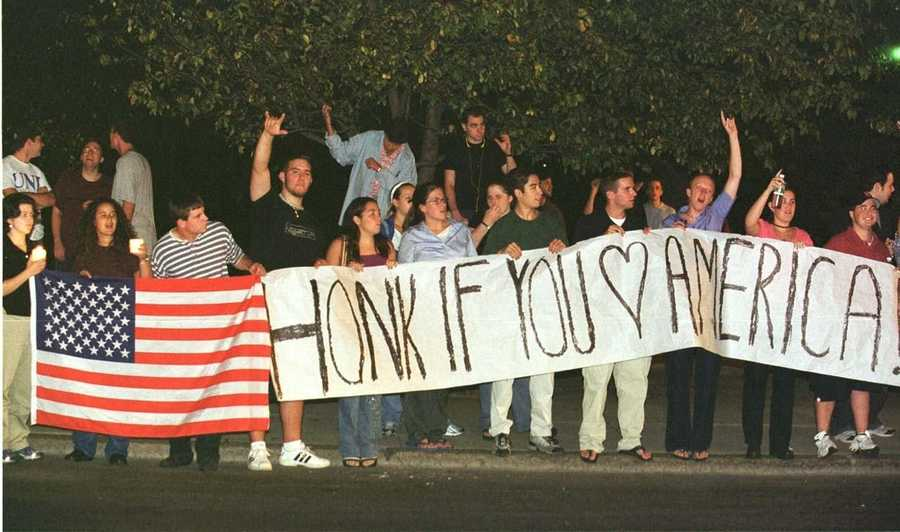 A crowd of nearly 300 young people, many Suffolk University students, wave flags and carry signs Sept. 12, 2001.